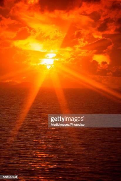 Orange sunbeams at sunset over the sea
