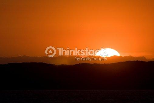 97dcb164a2 Orange Sunset Off The Coast Of Melbourne Australia Stock Photo ...
