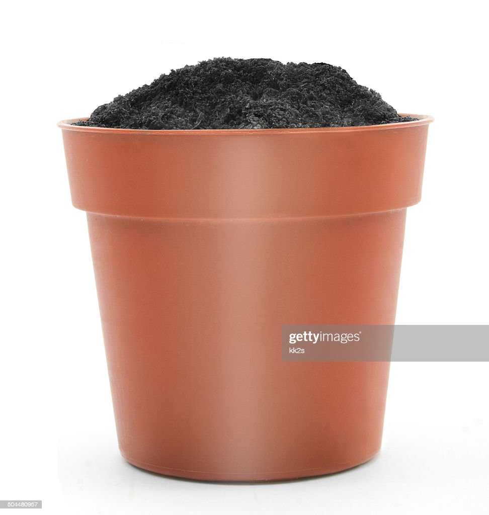 orange terracotta pot with soil isolated on white background stock photo