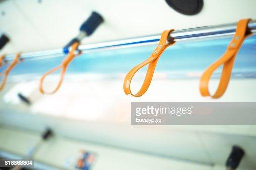 Orange tram handles : Stock Photo