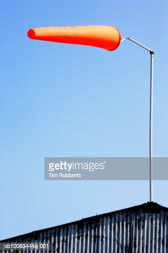 Orange windsock against blue sky : Stock Photo