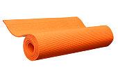 Orange yoga mat isolated on white