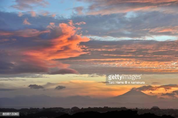 Orange-colored sunset clouds on Mt. Fuji in Japan