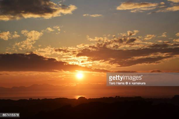 Orange-colored sunset clouds on Sagami Bay and Mt. Hakone