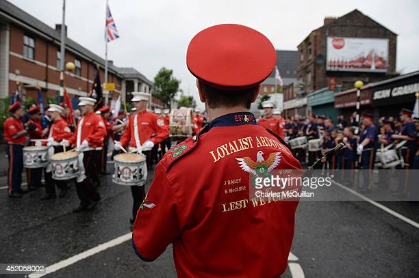 Orangeman band members play their drums during the annual 12th of July march as it made it's way through Belfast city centre on July 12 2014 in...