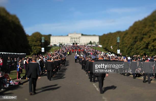 Orangemen march to the Stormont Parliament building in Belfast Northern Ireland on September 29 2012 Northern Irish police were on high alert...