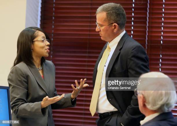 Orange/Osceola State Attorney Aramis Ayala left chats Monday March 20 2017 with State Attorney Brad King District 5 the newly appointed prosecutor