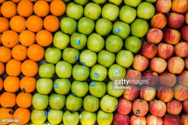 Oranges and apples sit on sale at a bus station in the Pettah neighborhood of Colombo Sri Lanka on Thursday April 20 2017 The Central Bank of Sri...