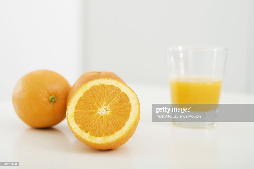 Oranges and glass of orange juice