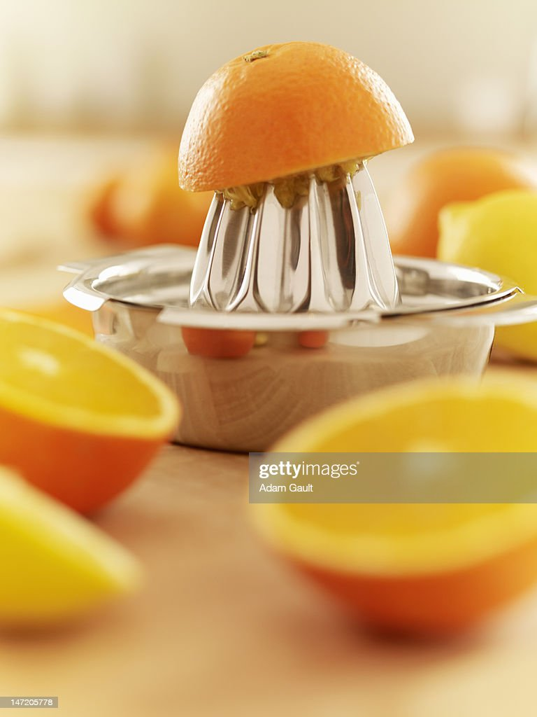Oranges and juicer : Stock Photo