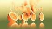 Orange juice splashing with drops of water.