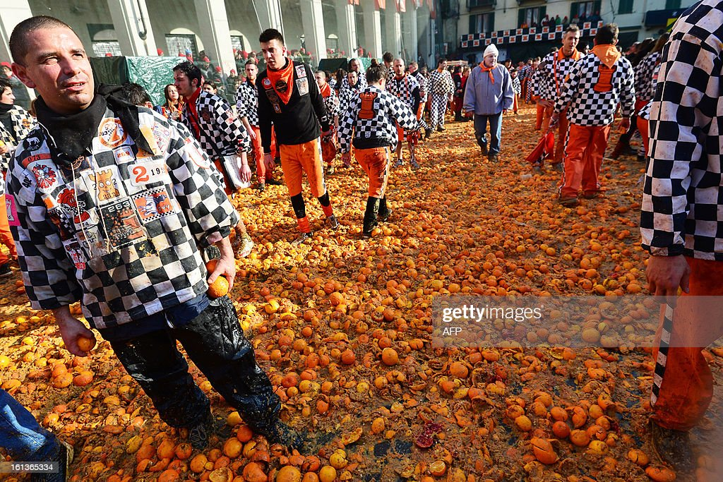 Oranges lay on the ground during the traditional 'battle of the oranges', held during the carnival in Ivrea, near Turin, on February 10, 2013. The event marks the rebellion of the people against tyrannical lords who ruled the town in the Middle Ages, with the revellers on carts representing guards of the tyrant, those on foot the townsfolk.
