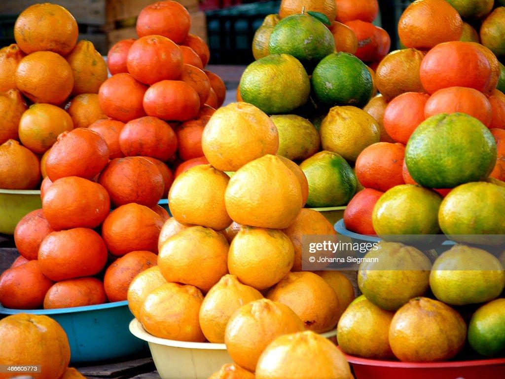 Oranges, lemons, and tomatoes : Stock Photo