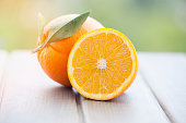 Orange isolated on wood background