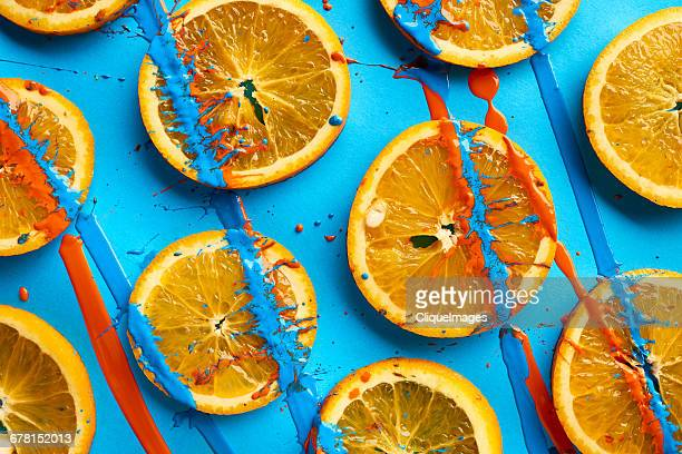 Oranges stained in paint