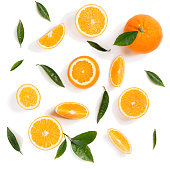 Background made of orange fruits and green leaves isolated on a white background. Top view.