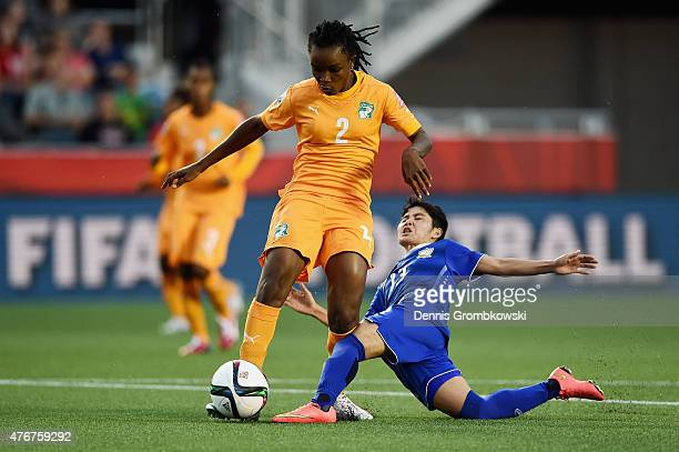 Orathai Srimanee of Thailand and Fatou Coulibaly of Cote D'Ivoire battle for the ball during the FIFA Women's World Cup Canada 2015 Group B match...