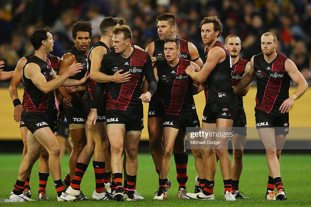Orazio Fantasia of the Bombers (C) celebrates a goal with teammates after half time during the round 10 AFL match between the Essendon Bombers and the Richmond Tigers at Melbourne Cricket Ground on May 28, 2016 in Melbourne, Australia.