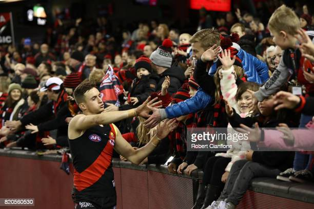 Orazio Fantasia of the Bombers celebrates with the fans after the Bombers defeated the Kangaroos during the round 18 AFL match between the Essendon...
