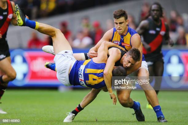 Orazio Fantasia of the Bombers grabs Liam Duggan of the Eagles in a headlock during the round nine AFL match between the Essendon Bombers and the...