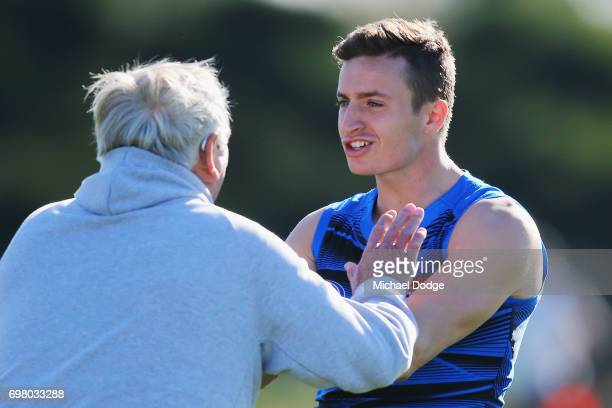 Orazio Fantasia of the Bombers playfullly tangles with a trainer during an Essendon Bombers AFL training session at True Value Centre on June 20 2017...