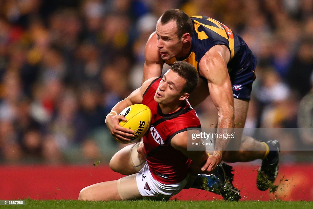 Orazio Fantasia of the Bombersmarks the ball against Shannon Hurn of the Eagles during the round 15 AFL match between the West Coast Eagles and the Essendon Bombers at Domain Stadium on June 30, 2016 in Perth, Australia.