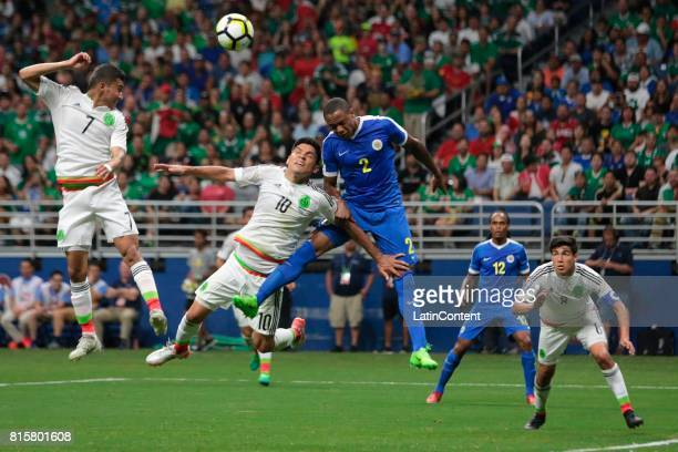 Orbelin Pineda and Martin Barragan of Mexico go for a header against Dustley Mulder of Curacao during a Group C match between Mexico and Curacao as...
