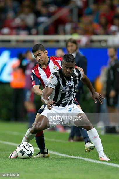 Orbelin Pineda of Chivas fights for the ball with Brayan Beckeles of Necaxa during the 17th round match between Chivas and Necaxa as part of the...
