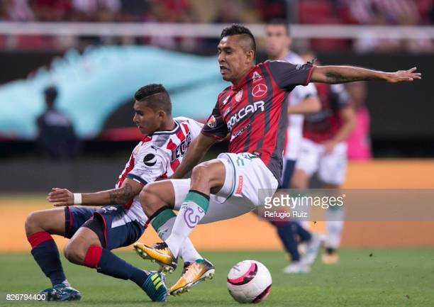 Orbelin Pineda of Chivas fights for the ball with Luis Hernandez of Necaxa during the third round match between Chivas and Necaxa as part of the...