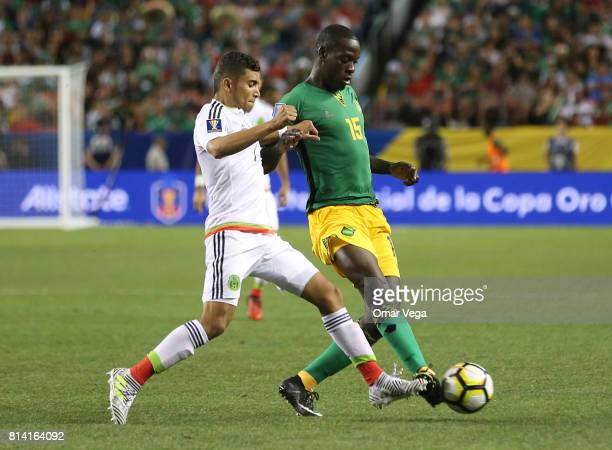 Orbelin Pineda of Mexico and JeVaughn Watson of Jamaica a Group C match between Mexico and Jamaica as part of CONCACAF Gold Cup 2017 at Sports...