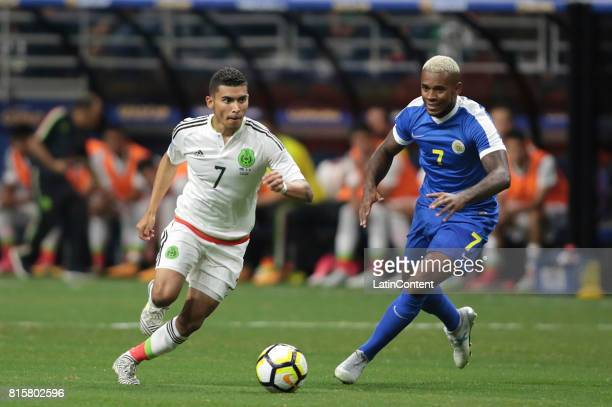 Orbelin Pineda of Mexico and Leandro Bacuna of Curacao compete for the ball during a Group C match between Mexico and Curacao as part of CONCACAF...