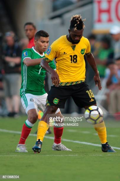Orbelin Pineda of Mexico and Owayne Gordon of Jamaica compete for the ball during a match between Mexico and Jamaica as part of CONCACAF Gold Cup...