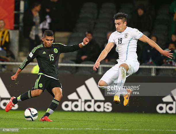 Orbelin Pineda of Mexico attempts a shot on goal as Erick Cabaco of Uruguay attempts to blocl during the FIFA U20 World Cup New Zealand 2015 Group D...