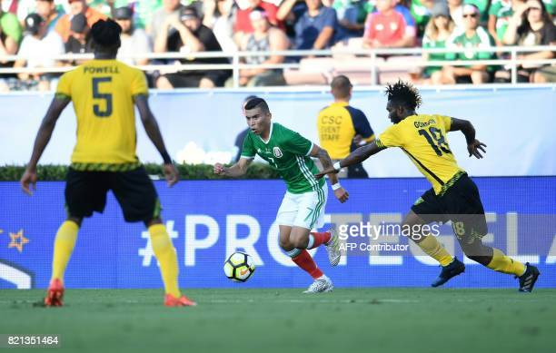 Orbelin Pineda of Mexico brings the ball up field past Owayne Gordon of Jamaica during their CONCACAF Gold Cup semifinal match on July 23 2017 at The...
