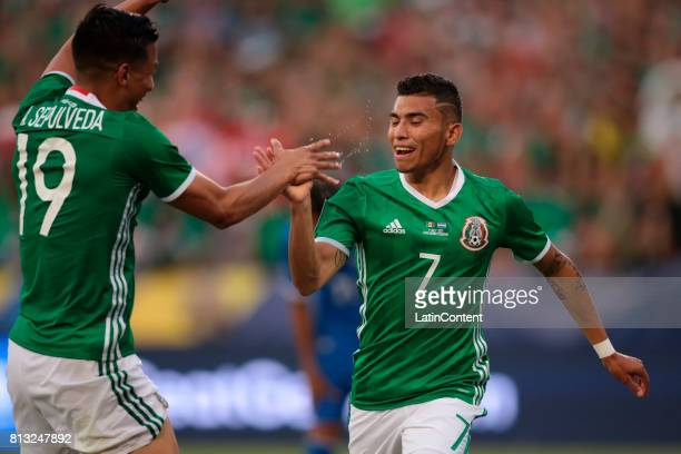 Orbelin Pineda of Mexico celebrates after scoring the third goal of his team with Angel Sepulveda during a Group C match between Mexico and El...