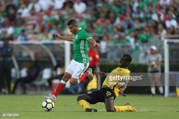 Orbelin Pineda of Mexico competes for the ball with JeVaughn Watson of Jamaica during a match between Mexico and Jamaica as part of CONCACAF Gold Cup...
