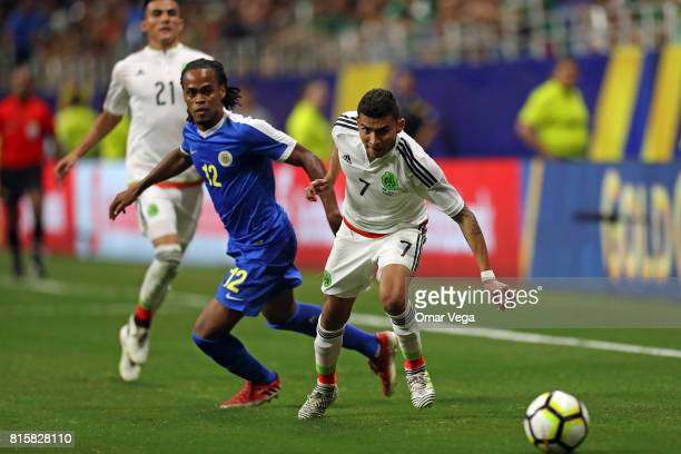 Orbelin Pineda of Mexico competes for the ball with Shanon Carmelia of Curacao during a Group C match between Mexico and Curacao as part of CONCACAF...