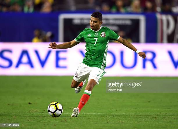 Orbelin Pineda of Mexico controls the ball against Honduras in a quarterfinal match during the CONCACAF Gold Cup at University of Phoenix Stadium on...