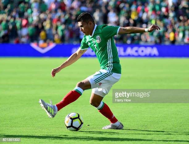 Orbelin Pineda of Mexico dribbles against Jamaica during the first half of the CONCACAF 2017 semifinal against Jamaica at Rose Bowl on July 23 2017...