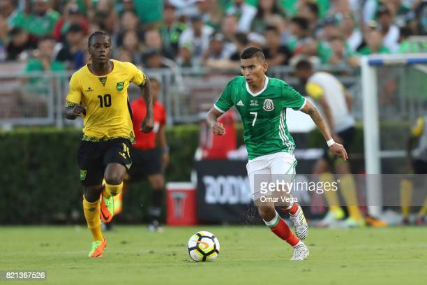 Orbelin Pineda of Mexico drives the ball during a match between Mexico and Jamaica as part of CONCACAF Gold Cup Semifinal at Rose Bowl Stadium on...