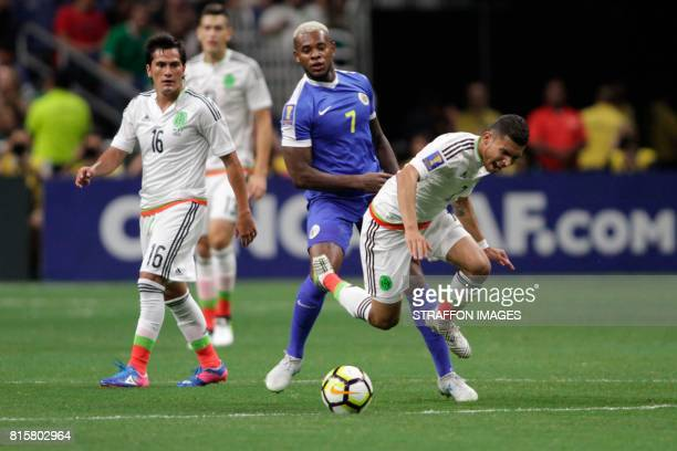 Orbelin Pineda of Mexico falls to the ground during a Group C match between Mexico and Curacao as part of CONCACAF Gold Cup 2017 at the Alamodome on...
