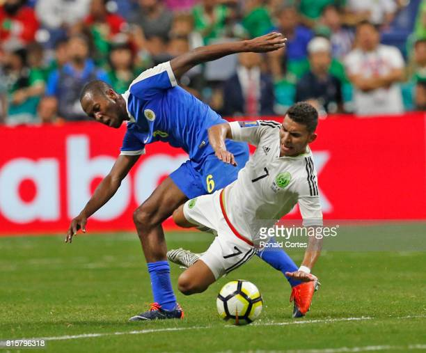 Orbelin Pineda of Mexico is tripped by Quentin Martinus of Curacao in the first half during the 2017 CONCACAF Gold Cup at Alamodome on July 16 2017...