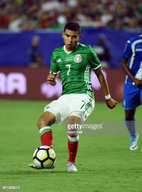 Orbelin Pineda of Mexico passes the ball against Honduras in a quarterfinal match during the CONCACAF Gold Cup at University of Phoenix Stadium on...