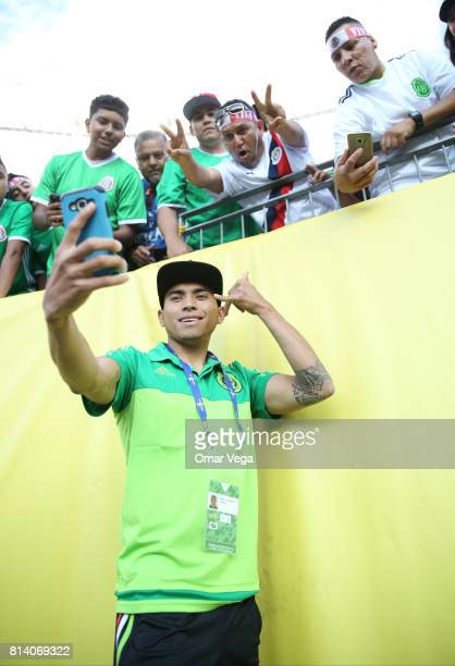 Orbelin Pineda of Mexico takes pictures with fans prior to a Group C match between Mexico and Jamaica as part of CONCACAF Gold Cup 2017 at Sports...