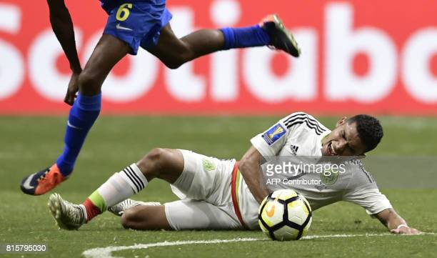 Orbelin Pineda of Mexico tumbles before Quenten Martinus of Curacao during their CONCACAF Gold Cup soccer match on July 16 2017 at the Alamodome in...