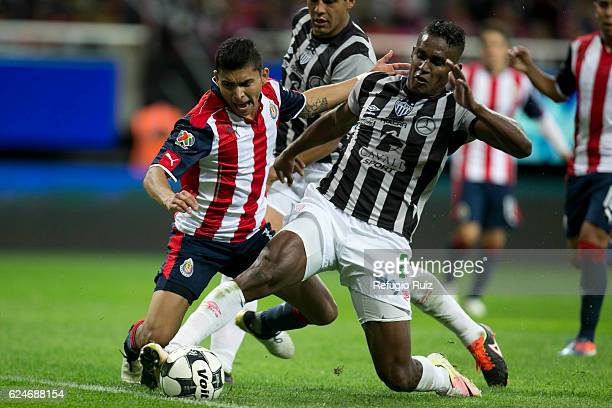 Orbelín Pineda of Chivas fights for the ball with Brayan Beckeles of Necaxa during the 17th round match between Chivas and Necaxa as part of the...