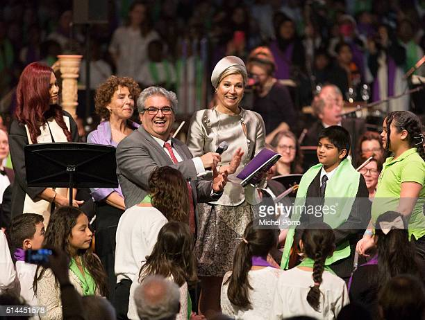 Orchestra founder and director Marco de Souza and Queen Maxima of The Netherlands attend the ten year anniversary of the 'Leerorkest' Learning...