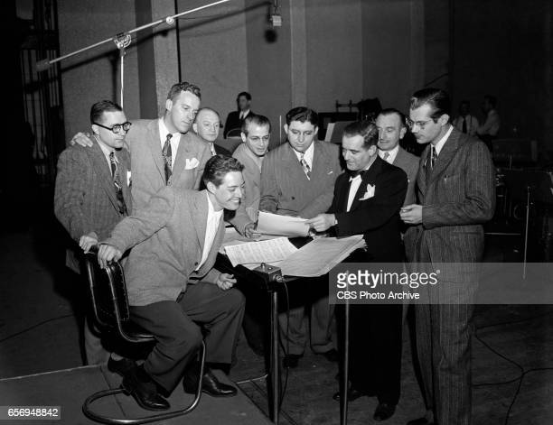Orchestra leader Mark Warnow rehearses with 'The Hit Paraders' for CBS Radio's popular songs program 'Your Hit Parade' Also pictured are singer Andy...