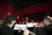 Orchestra Performing in a Theatre