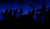 Silhouette of a jazz orchestra on a blue backdrop